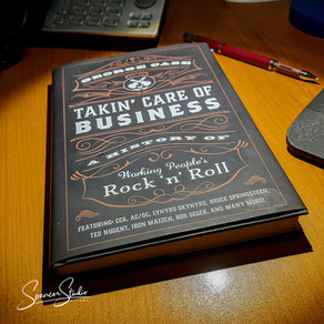 """""""Takin' Care of Business: A History of Working People's Rock 'n' Roll."""""""