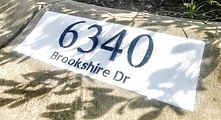"Basic Black and White Reflective curb address painting with 4"" numbers and 1"" street name"