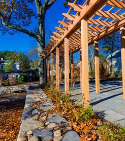 Dry laid stone walls, pergola, bluestone walkway (carpentry by Dave Chua, design by Gordon Hayward)