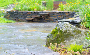 Dry laid Goshen stone wall, Goshen stone terrace, and mossy boulder