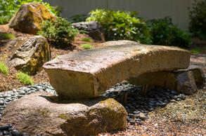 Reclaimed granite stone bridge and dry stream bed (design by Sallie Hill Design)