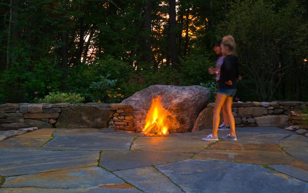 Boulder firepit and Goshen stone terrace