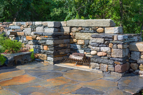 Fireplace built in wall- mixed granite, Goshen and fieldstone, with Goshen stone patio