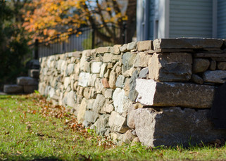 Dry laid fieldstone and granite stone wall and granite steps