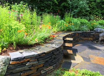 Goshen stone wall, stile steps, and pollinator planting