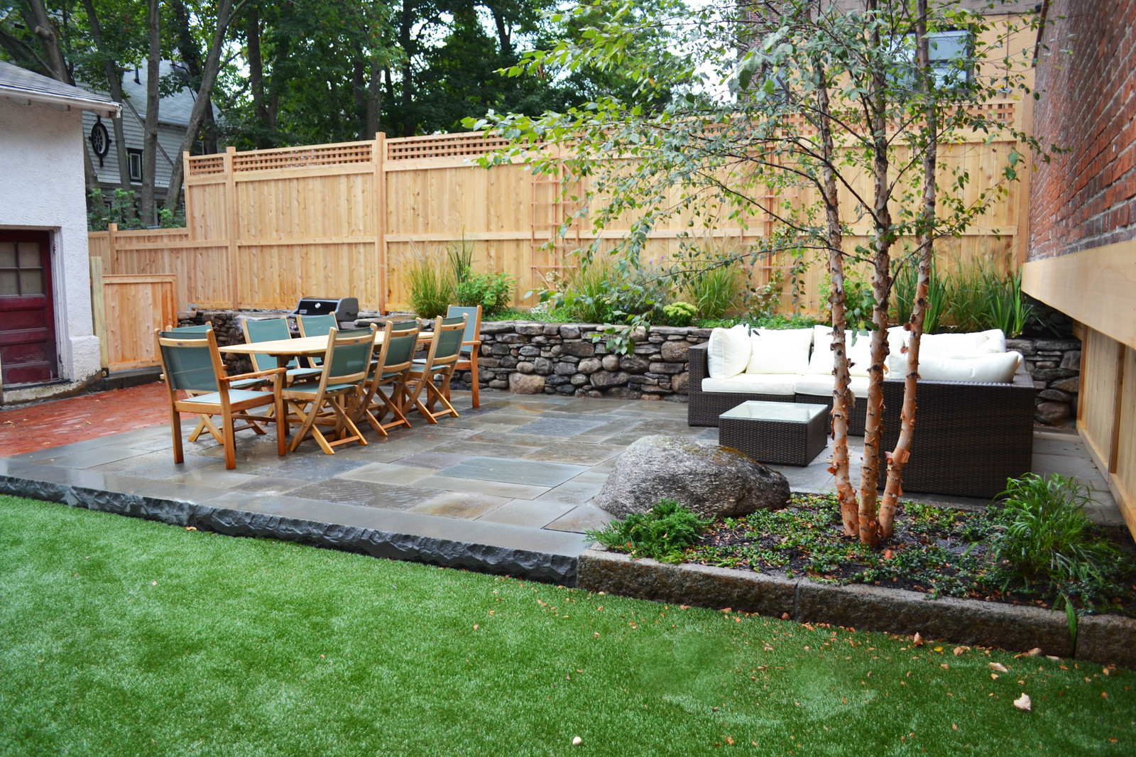 Bluestone terrace, cedar fence, artificial turf and plantings