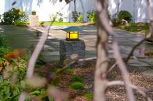 Lanterns on granite posts (design by Sallie Hill Design)