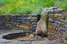 Boulder firepit, Goshen stone wall, and firepit surround