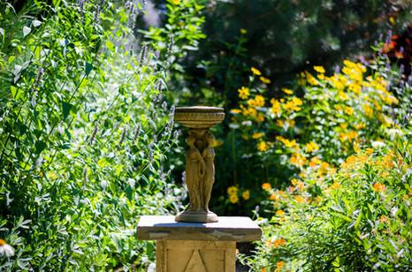 Native garden parterre statue