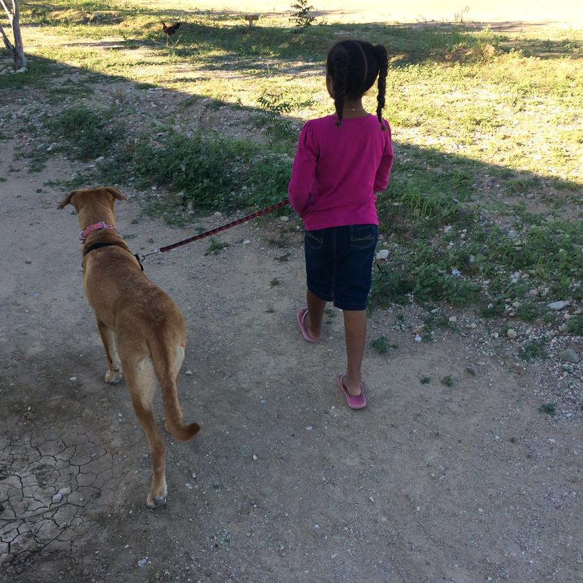 Ani walking our dog, Roxy