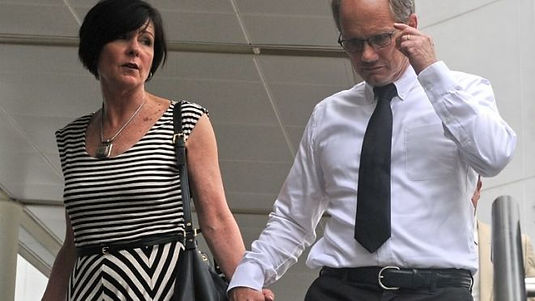 "Rick Todd and his wife Mary, pictured at the Subordinate courts in Singapore, on May 21, 2013. The family of an American scientist found hanged in Singapore last year dismissed on Tuesday the city-state's findings that he committed suicide as ""a sham and a"