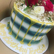 3 layer cake with fresh flowers