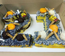 Number cake with liquor bottles