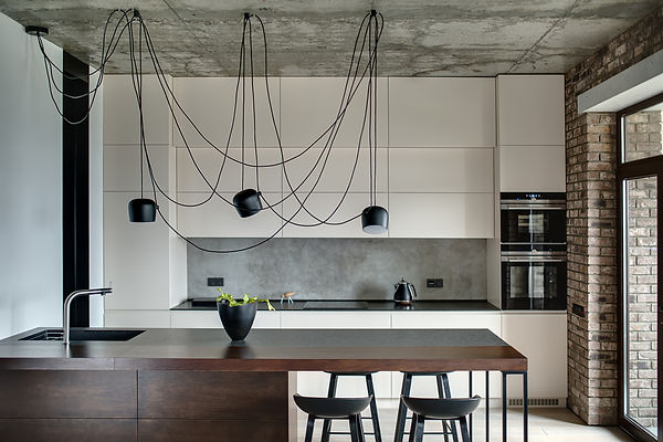 Kitchen in a loft style with concrete an