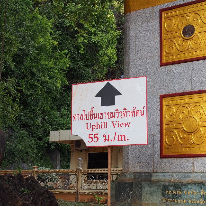 At the top of the stairs is a large buddha, as well as an expansive view of the Krabi province.