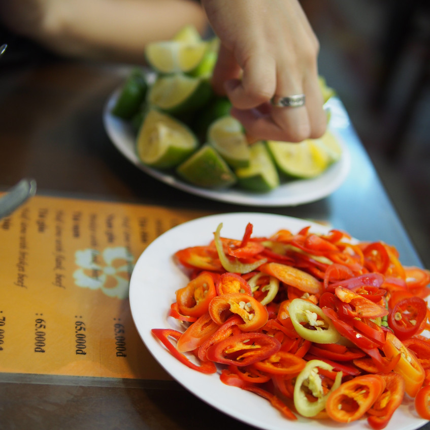 In Vietnam there is no Sriracha and hoisin sauce. To add more spice to the broth, fresh chili peppers are always offered.