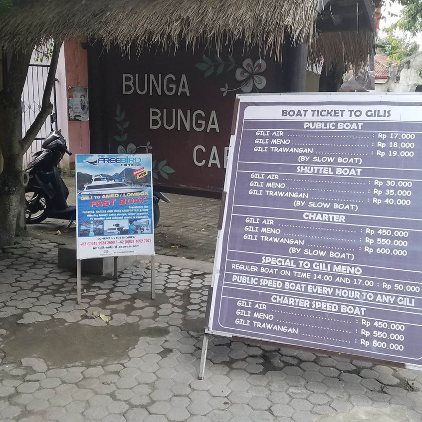 This is where the shuttle guy dropped us off. Bunga Bunga cafe is owned by one of the boat captains. Here's a board with all the prices for the boats.