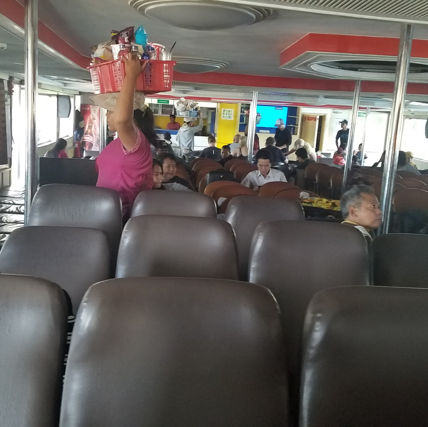 There were a handful of women who went around with snack baskets. Last minute snacks before the ferry departs.