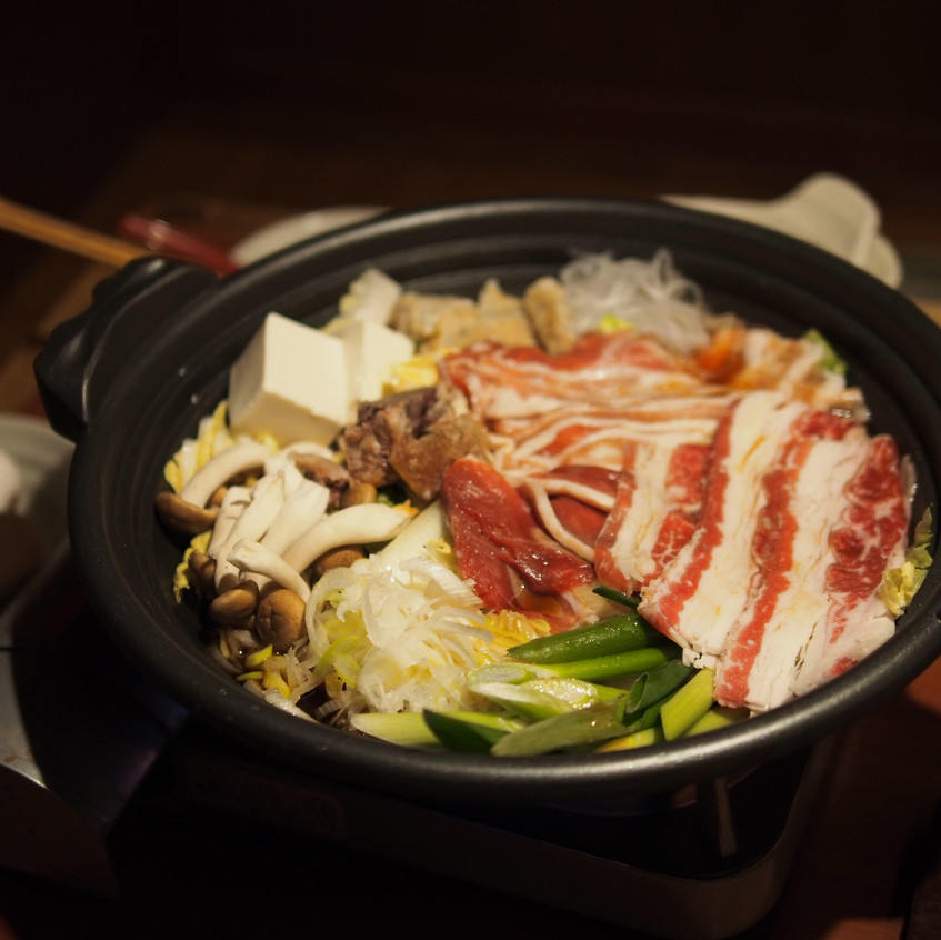 Nabemono or simply nabe, is a hot pot dish. Meat, veggies, tofu and rice noodles are boiled in delicious dashi (broth).