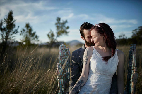 Wedding photography, wilderness elopement, couple share a moment in sunkissed field