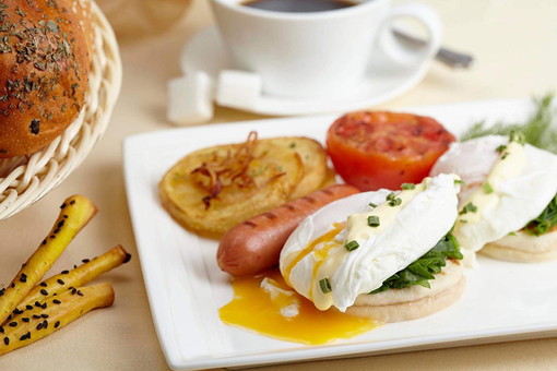 Food photography, poached egg and sausage breakfast