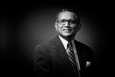 Corporate headshot, black and white of man in suit