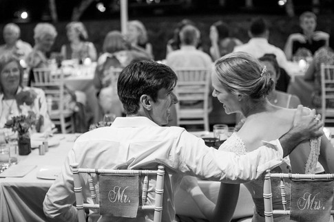 Wedding photography, couple chats to each other during reception