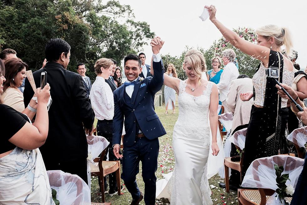 Wedding photography Tasmania, couple walk down the aisle at outdoor wedding
