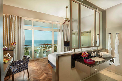 Architectural photography, interior of resort hotel room overlooking the blue sea