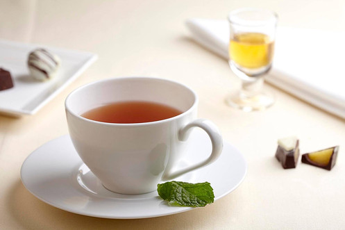 Food photography, mint tea with chocolates & liqueur