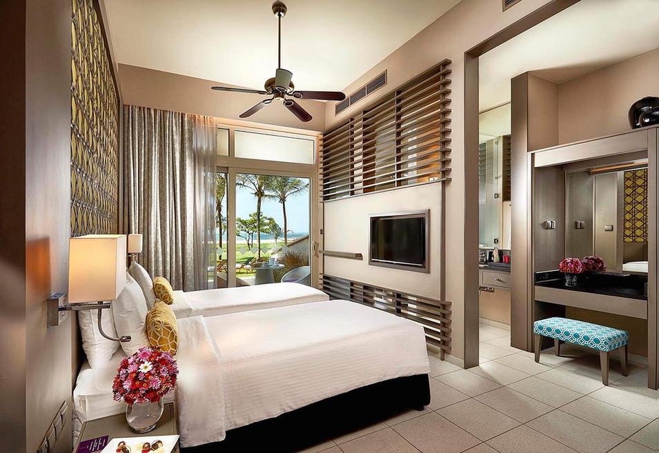 Architectural photography, interior of resort hotel room overlooking garden