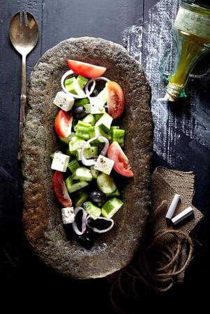 Food photography greek salad in rustic setting