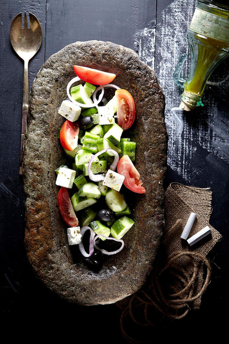 Food photography, greek salad in stone bowl
