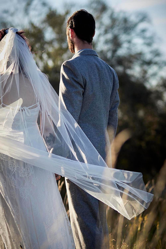 Wedding photography, wilderness elopement Tasmania, couple walks away from camera