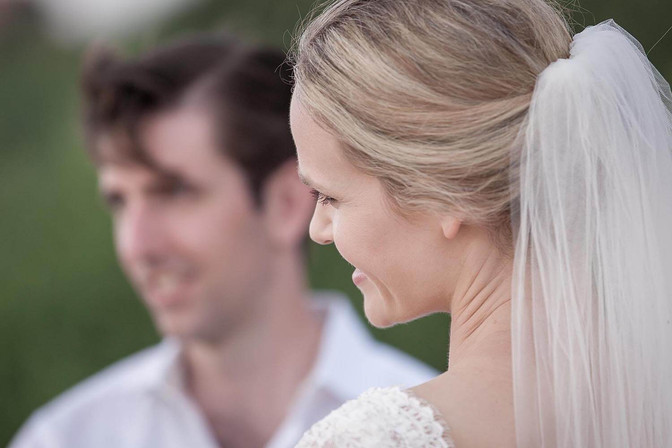 Wedding photography, abstract of bride with groom in background