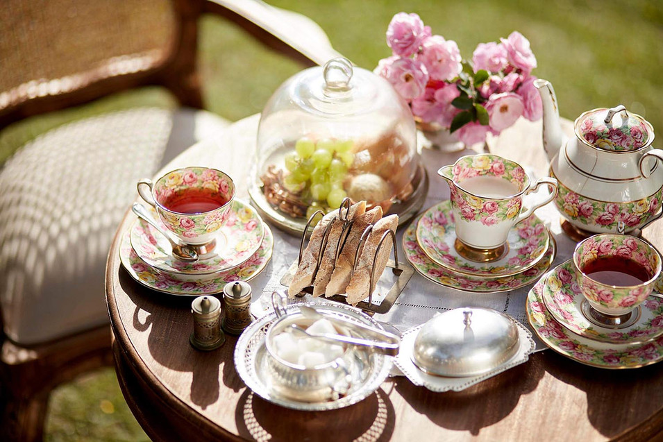 Lifestyle photography, vintage tea set and high tea setup, outdoor in late afternoon sun