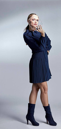 Studio fashion photography blue dress and boots