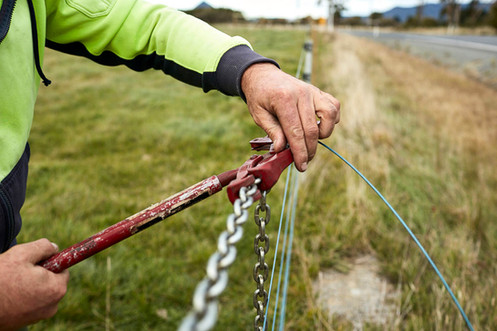 Fixing a wire fence on a farm