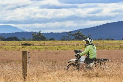 Ag bike and farmer in paddock