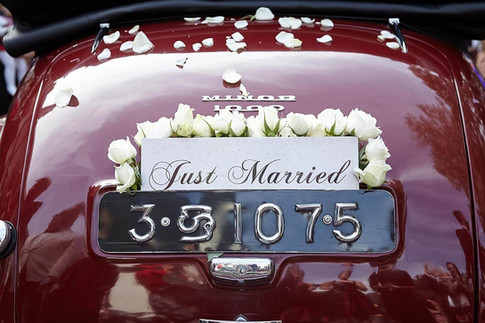 Wedding photography, just married classic car with flowers