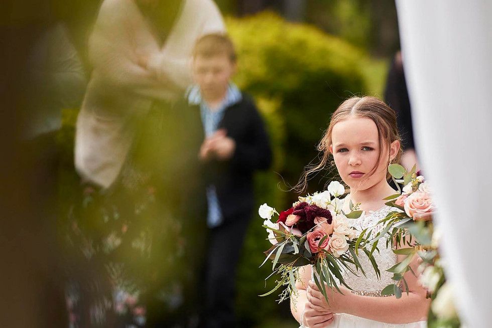 Wedding photography, flower girl with flowers in hand