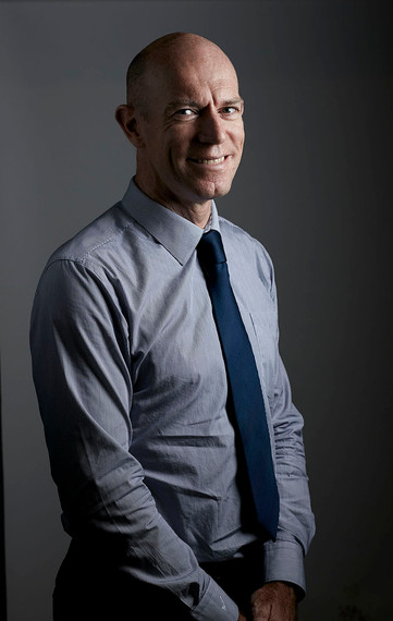 Corporate headshot, businessman in studio