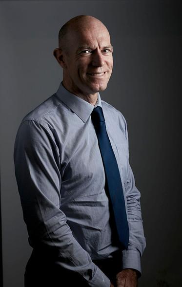 Corporate headshot, businessman in studio