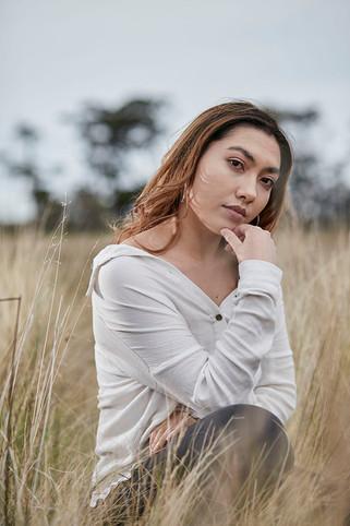 Outdoor portrait, girl in dried grass field