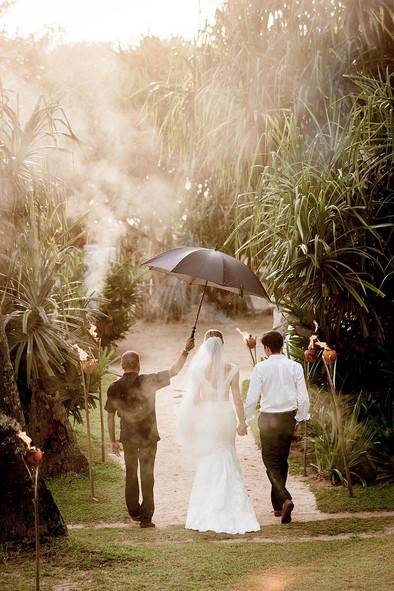 Wedding photography, exotic elopment couple walks away from camera in tropical setting