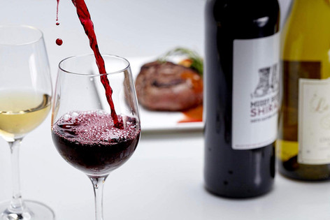 Food photography, red wine pours into wine glass
