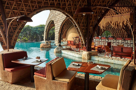 Architectural photography, interior of bamboo domed restaurant of safari lodge adjoining pool, Wild Coast, Sri Lanka