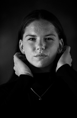 Black and white studio heashot of girl