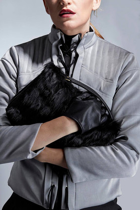 Studio fashion photography faux leather bag and jacket
