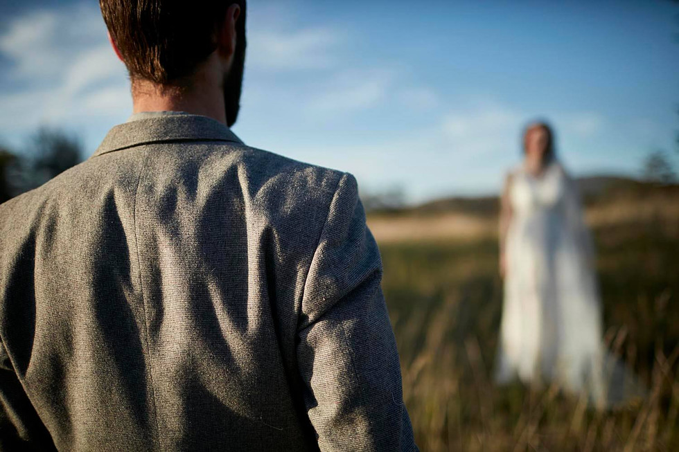 Wedding photography, wilderness elopement Tasmania, groom looks on at bride, abstract photography